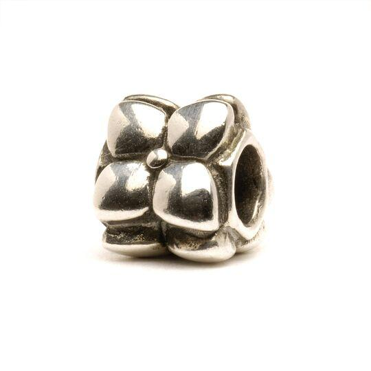 Trollbeads silver bead called Flowers, with three flowers around the bead, each with four petals