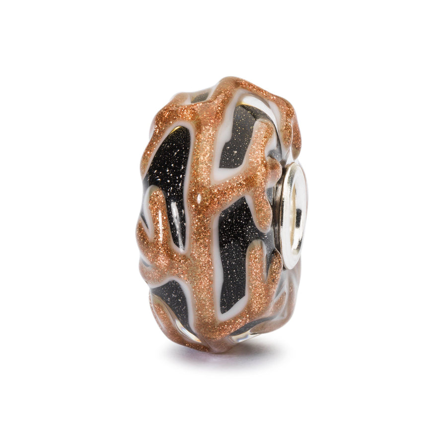 A glass charm bead for a Trollbeads bracelet, bangle or necklace in black with a raised patterns of golden, glittering 'branches'