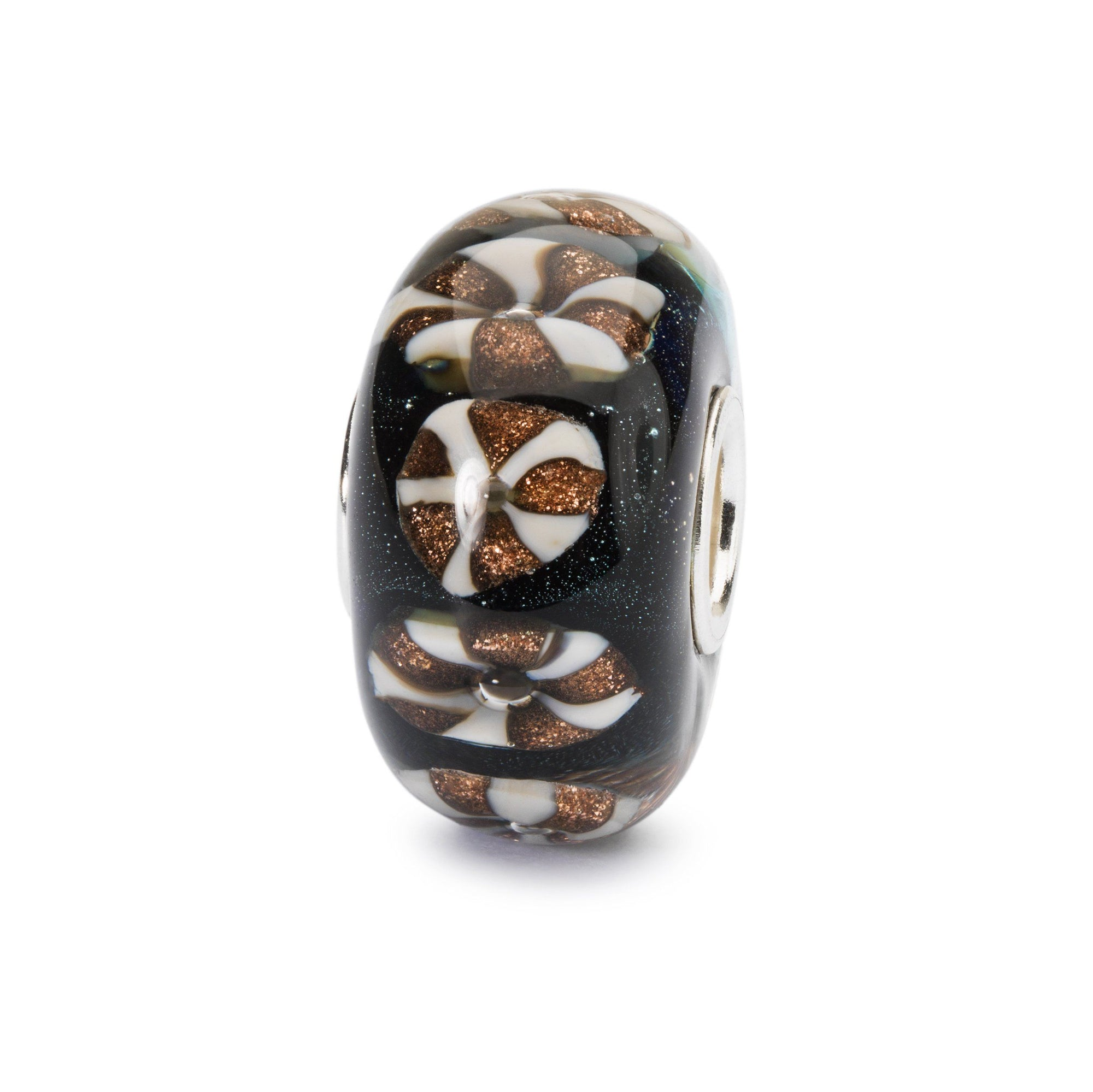 Modern glass charm bead in black with star-like specks of glitter, overlaid with alternate white and golden-glitter wheels.