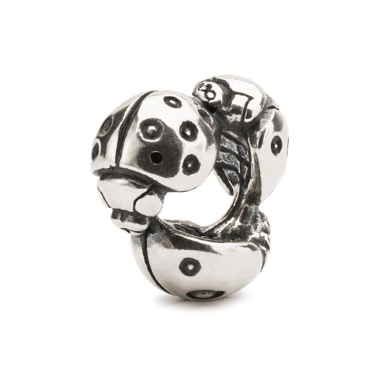 Silver bead made up of three ladybirds joined head to tail forming a silver bead for a modern Trollbeads charm bracelet