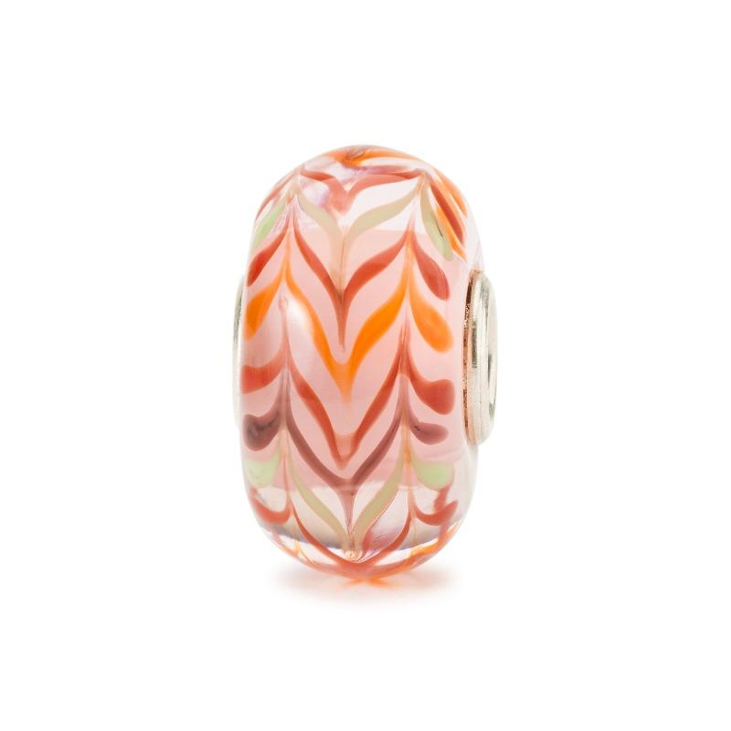 Italian glass charm bead in pale orange and beige with stripes of orange, red and beige