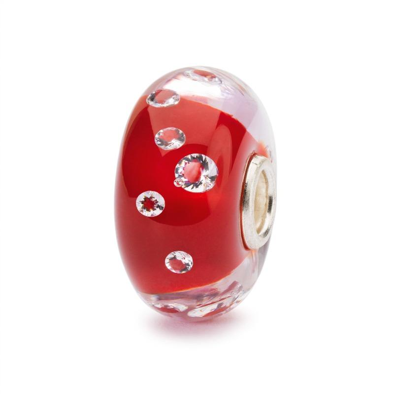 Modern charm bead made of glass in scarlet red with 13 cubic zirconia's suspended in the glass