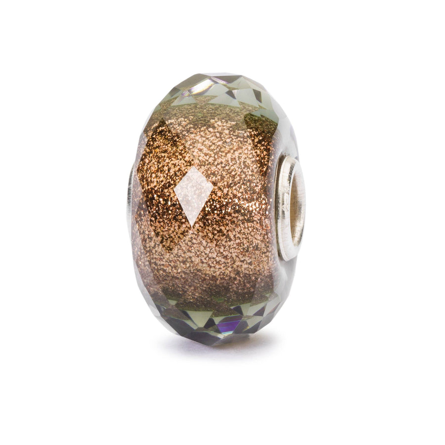 A Trollbeads limited edition glass bead with copper shimmering glitter inside called Sense of Shimmer for Black Friday 2019