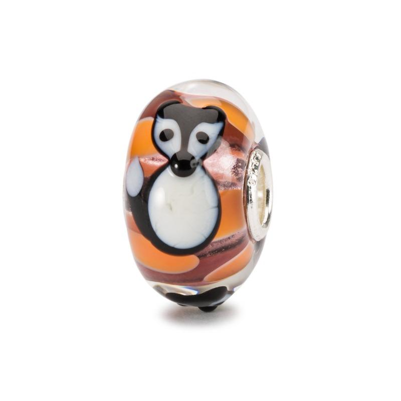 Trollbeads orange glass bead with a black and white animal overlay