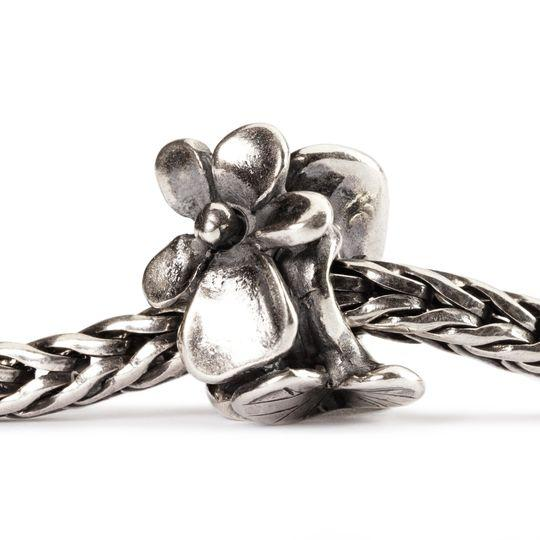 Silver charm bead featuring a voilet flower and pearl for the month of February to fit a Trollbeads bracelet