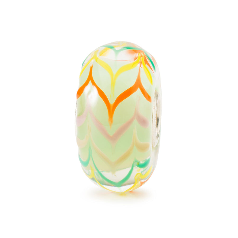 Modern glass charm bead for a Trollbead bracelet with green backgrounds and zigzag strokes of pink, green and orange