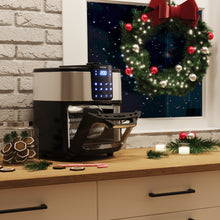 Load image into Gallery viewer, hOme air fryer oven on a counter top demonstrating use