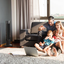 Load image into Gallery viewer, black remote controlled portable tower fan family using a laptop
