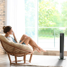 Load image into Gallery viewer, black remote controlled portable tower fan women in the garden