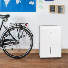 Load image into Gallery viewer, white home 50 pint dehumidifier next to a bike