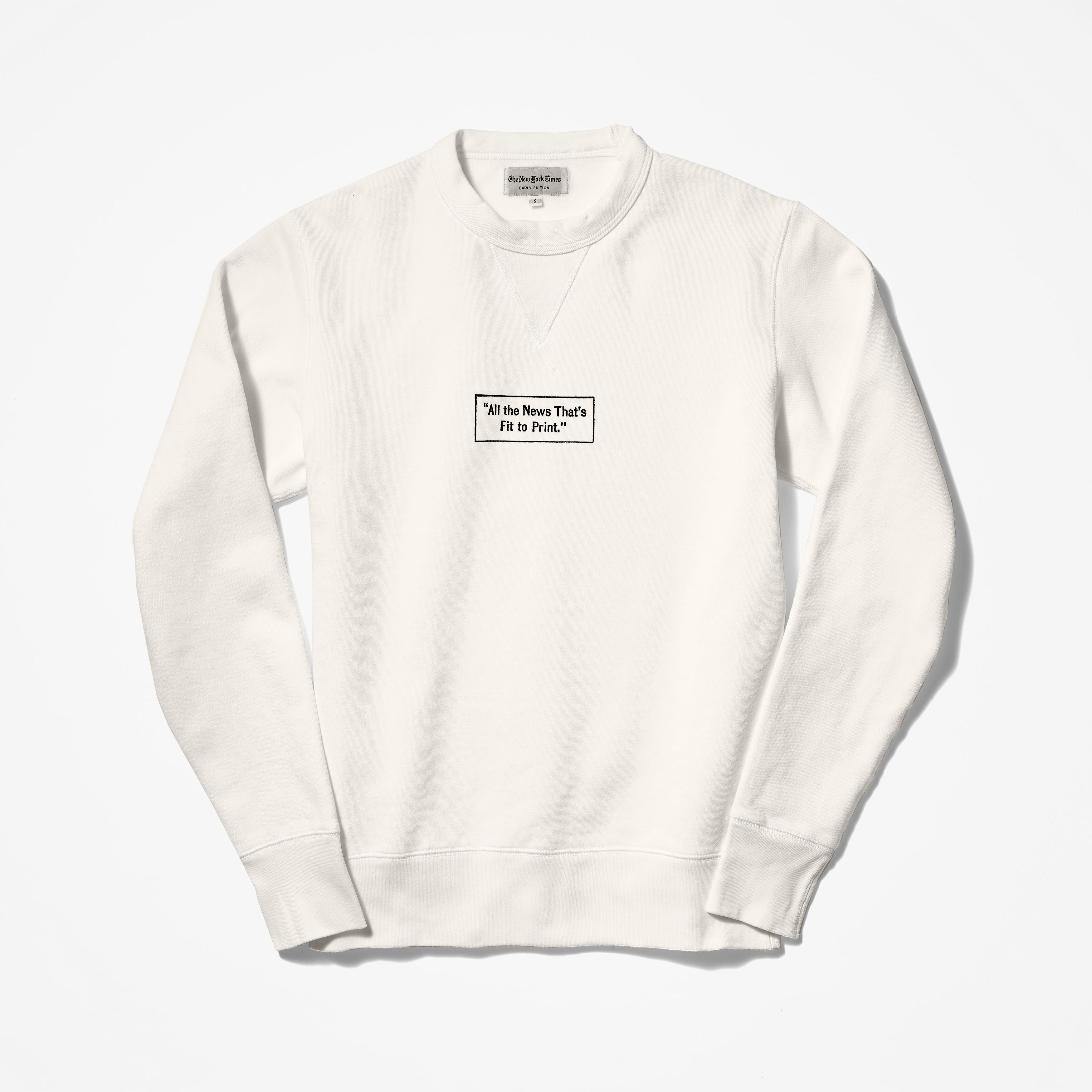 All the news sweater
