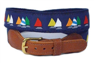 Men's nautical sailboat ribbon belt comes in multi colored sails on a navy ground