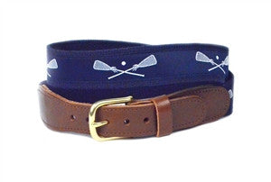popular lacrosse belt on a navy background with white lacrosse sticks crossed
