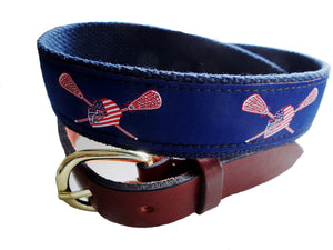 Popular lacrosse belt with navy background and complimented red white and blue helmut and sticks