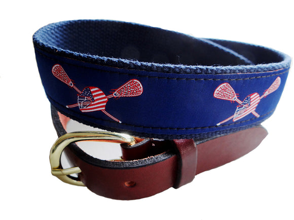 Popular Navy lacrosse ribbon belt complimented with a white and red helmut and crossed sticks