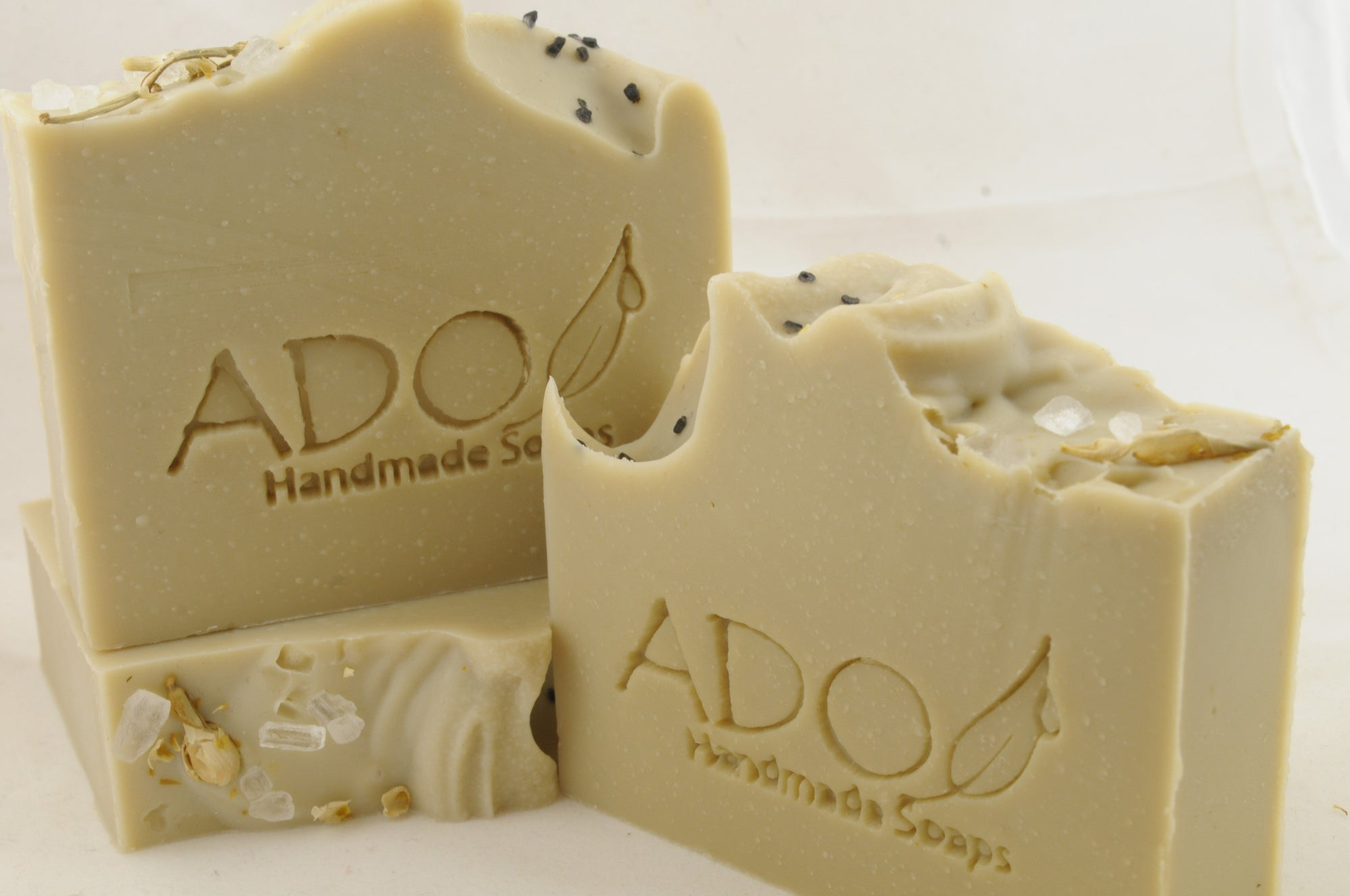 a group of three bars of laurel berry soap against a plain background