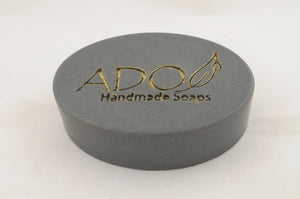 logo prominant image of charcoal soap against a plain background