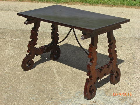 Antique folding scalloped-leg campaign table with iron stretchers, walnut