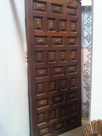 Single panel double-faced raised panel door in pine and oak