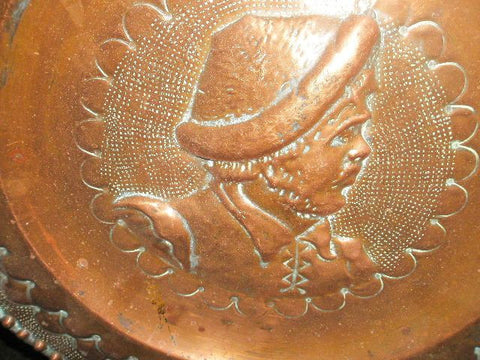 Antique embossed copper tavern plates