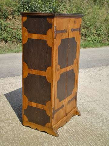 Antique carved single-door carved linen-fold cabinet, oak and chestnut