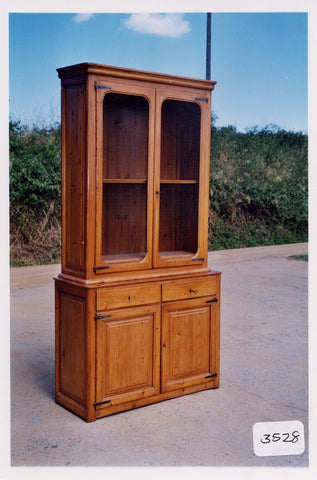 Antique four-door, two-drawer pantry cabinet, honey pine