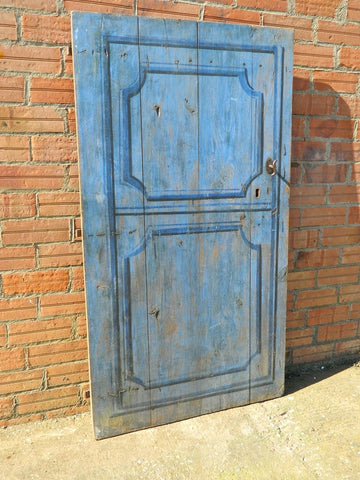 Single-panel honey pine arched door
