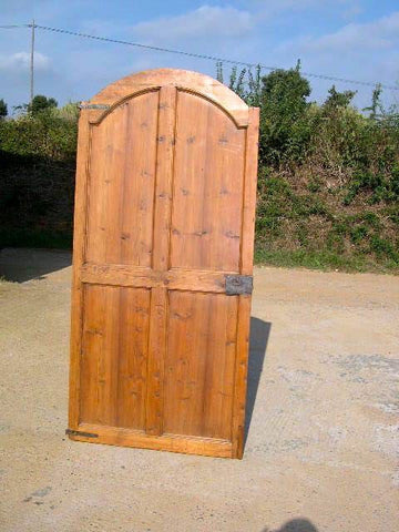 Antique single-panel arched door, honey pine