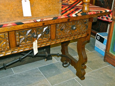 Carved three-drawer reproduction lyre leg table with iron stretchers, cachimbo hardwood