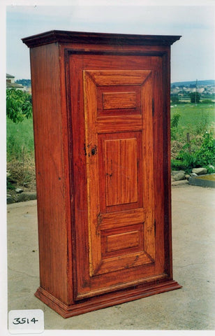 Two-door oak pantry cabinet with carved Basque motifs