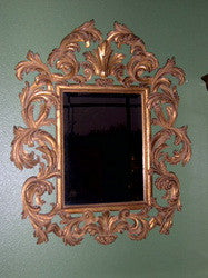 "Reproduction hand-carved and gilt ""Pitti"" mirror with beveled glass"