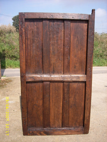 Antique planked chestnut wine cellar door