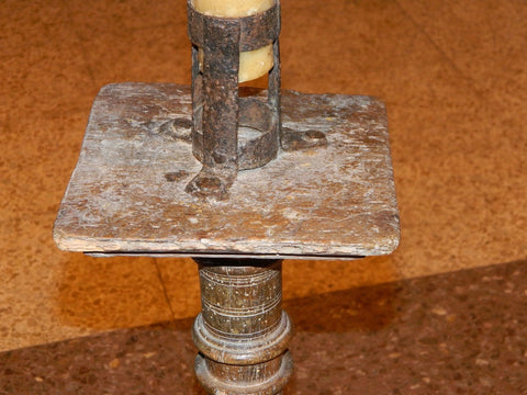 Antique oak floor candlestick with wrought iron candleholder