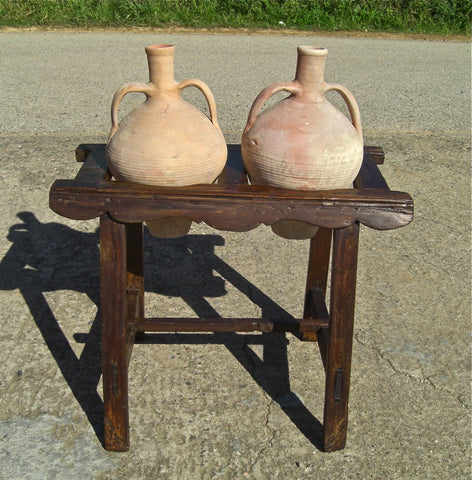 Antique two-hole poplar water jug stand with original clay jugs