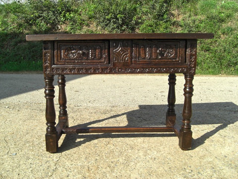 Antique trestle leg writing table with iron stretchers, walnut