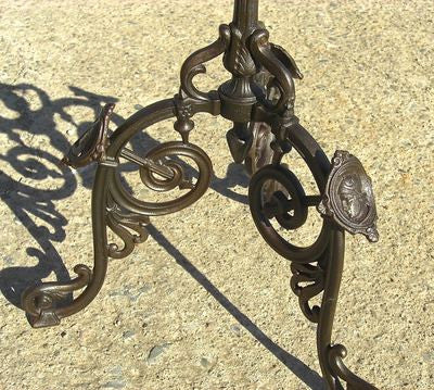 Antique cast and wrought iron floor candlestick