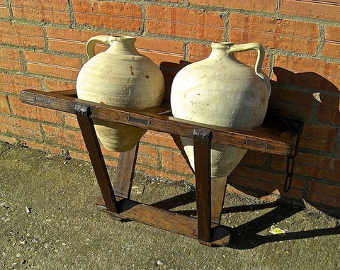 Antique portable water jug carrier with original clay jugs, pine