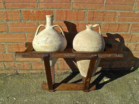 Antique portable water jug carrier with original clay jugs, pine.