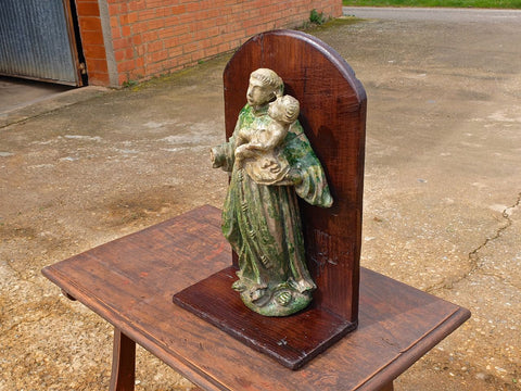 Antique glazed terracotta statue of St. Anthony with Child