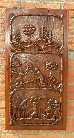 Carved two-cherub walnut panel