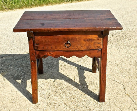 Antique single-drawer trestle leg table with scalloped stretchers and pen knife carving, walnut and poplar