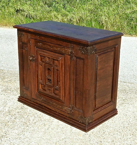 Antique carved single-door credenza, oak and walnut