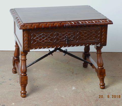 Antique carved single-drawer accent table with iron stretchers, walnut