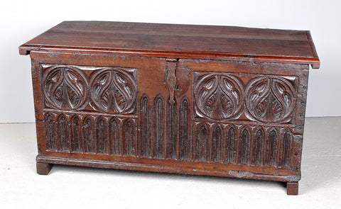Antique carved neo-Gothic village chest, chestnut