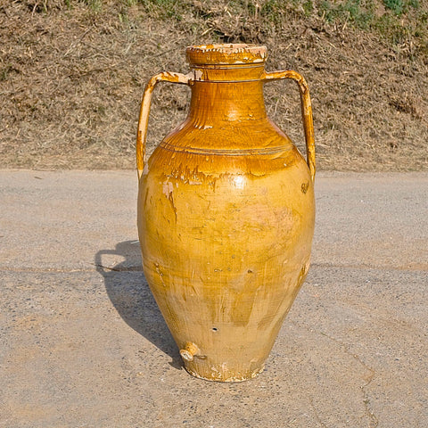 Antique hand-streaked terracotta water jug.