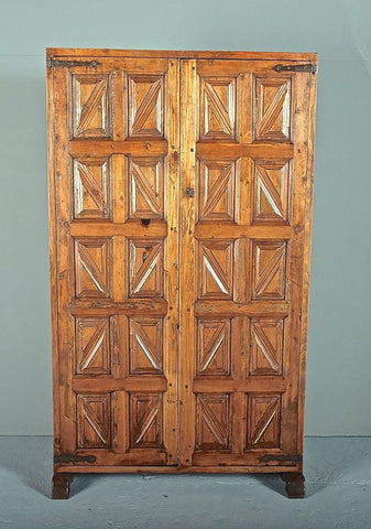 Antique carved two-door pantry cabinet, pine