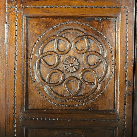 Antique carved two-door chestnut credenza