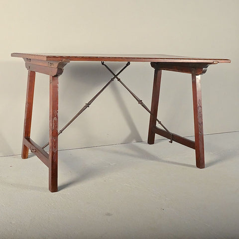 Antique mahogany campaign table with iron stretchers