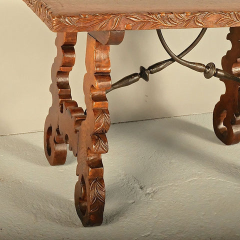Antique lyre leg accent table with carved edge top & iron stretchers