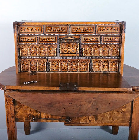 Antique inlaid Castilian vargueno with multiple drawers, walnut with boxwood inlay